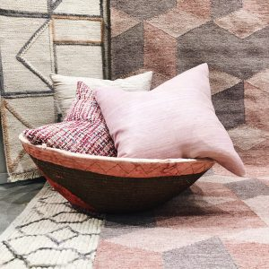 jaipur pink gray rugs pillows in basket